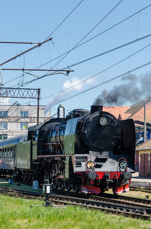 STEAM LOCOMOTIVE - Old train at railway crossings