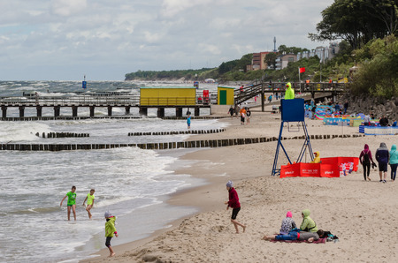 bathwater: USTRONES OF THE SEA, WEST POMERANIAN  POLAND: Sea Beach - Red flag hung out by rescuers, no bath in the sea