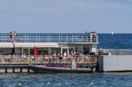 the furlough: KOLOBRZEG, WEST POMERANIAN  POLAND - 2017: Holidaymakers at cafeteria tables Editorial