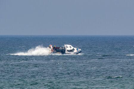 PATROL BOAT - Police boat in patrol action at sea Stock Photo