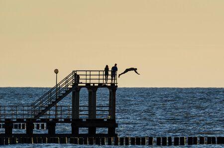 BEACH HOLIDAY - Small coastal pier at sunset