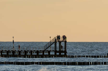 entertaiment: BEACH HOLIDAY AND SELFIE- Small coastal pier at sunset Stock Photo