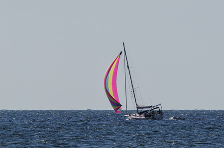 spinnaker: YACHT - Yacht under sail at sea Stock Photo