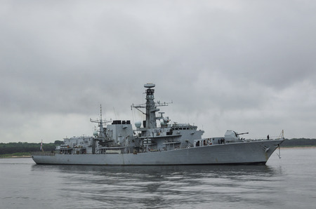 FRIGATE - His Majesty's Royal British Ship sails into the sea 写真素材