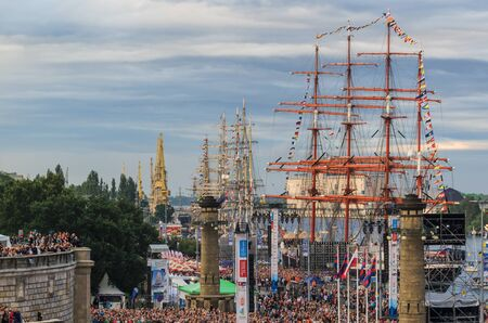 SZCZECIN, WEST POMERANIAN  POLAND: Final Tall Ships Races. Sailing ships at the waterfront and thousands of people at the concert