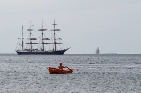 BALTIC SEA  POLAND: Lifeguard on the background of the Sedov sailing ship in Tall Ship Races Editorial