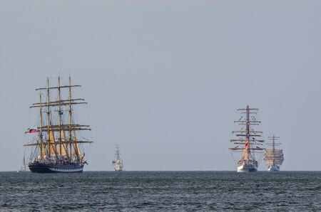 SAILING SHIPS - Kruzensztern, Dar Younger and Shabab Oman in the parade of sailing ships at sea Stock Photo