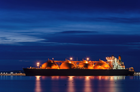 LNG TANKER - Sunrise over the illuminated ship Stock Photo - 86111386