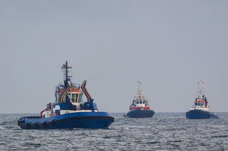 TUGS - Two tugs and fireboat at sea Stock Photo - 86687607
