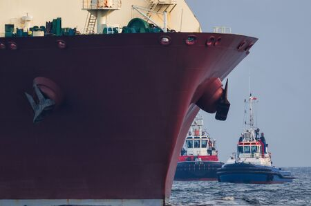 TANKER AND TUGS Stock Photo - 87491038
