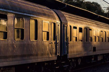 windows: RAILWAY WAGONS - Passenger train wagon on the platform of the train station