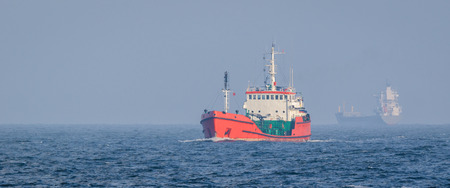 TANKER - red ship to carry fuel at sea Stock Photo
