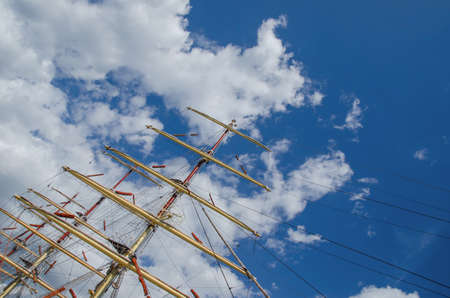 SAILING SHIP - Masts of a sailing ship against the sky