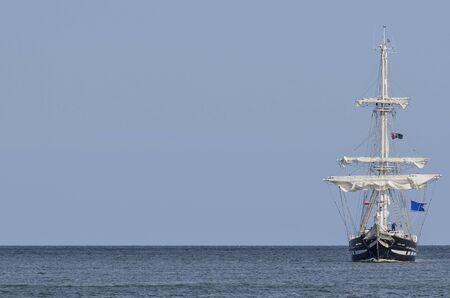 SUMMER SEASCAPE - Sailing ship on the horizon Stock Photo
