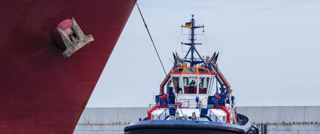 TUG AND GAS CARRIER - Tug when working with a big ship