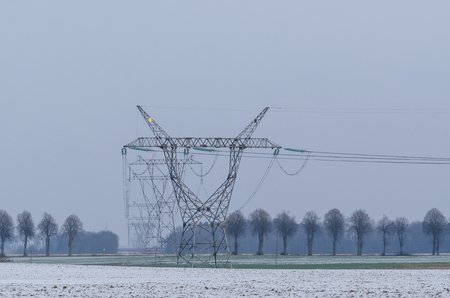 POWER ENGINEERING - High voltage line among fields Stock Photo