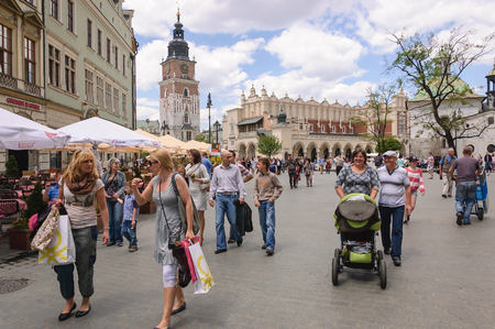 KRAKOW / POLAND: Tourists and residents stroll around the main square