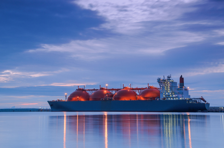 LNG TANKER AT THE GAS TERMINAL - Sunrise over the ship and port Banco de Imagens