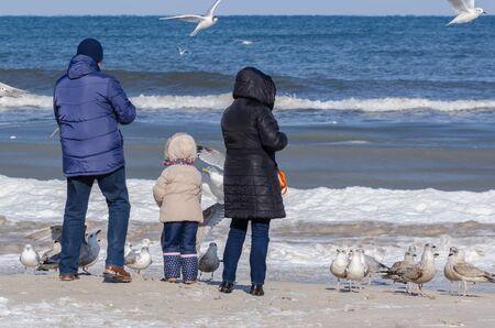 FAMILY - A winter walk by the sea beach