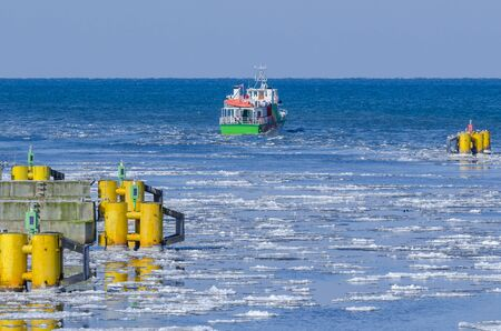 EARLY SPRING AT SEASIDE - A walking ship, exit from port and floe