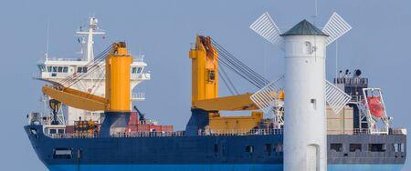 GENERAL CARGO SHIP - Exit of a merchant ship to the sea Stock Photo