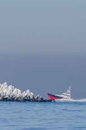 SEARCH AND RESCUE - The sea rescue boat comes back to the port Stock Photo