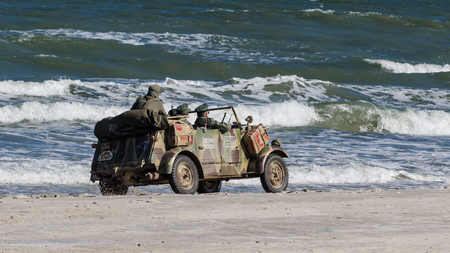 KOLOBRZEG, WEST POMERANIAN / POLAND - 2018: Reconstruction of battle for Ko?obrzeg - German military vehicle on the sea beach before the show