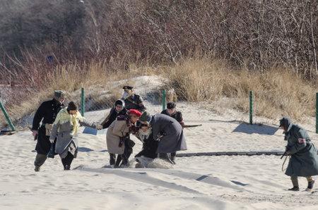 KOLOBRZEG, WEST POMERANIAN  POLAND - 2018: Reconstruction of battle for Ko?obrzeg - Escape of civilians from the sea