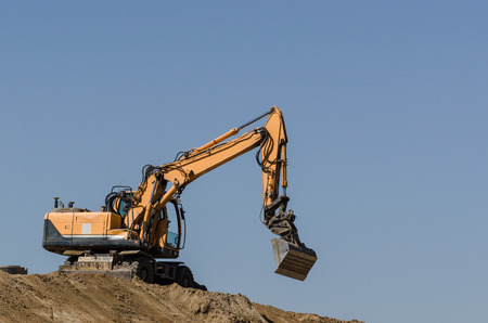 Excavator vehicle at work on construction site Stock Photo