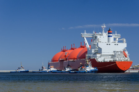 LNG TANKER - A red ship at the gas terminal