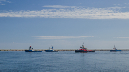 TUGS - Auxiliary ships on the waterway Stock Photo