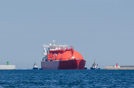 Red ship enters the port Stock Photo