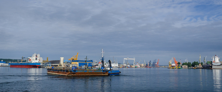 BARGE AND TUGBOAT - Morning traffic at the sea port in Gdynia Stock Photo