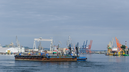 BARGE AND TUGBOAT - Morning traffic at the sea port in Gdynia Foto de archivo