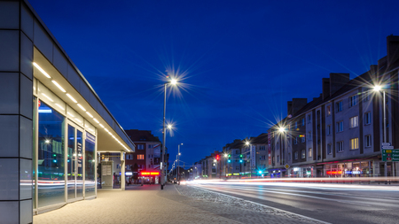 KOSZALIN, WEST POMERANIAN  POLAND - 2018: Night city - The main street of city and bus stop at Town Hall Square