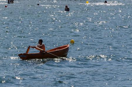 KOLOBRZEG, WEST POMERANIAN  POLAND - 2018: The water rescuer patrols sea shore on a lifeboat Editorial