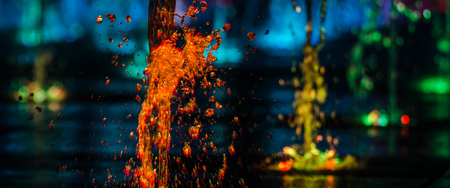 VOLCANO - Colorful fountain in the night city landscape
