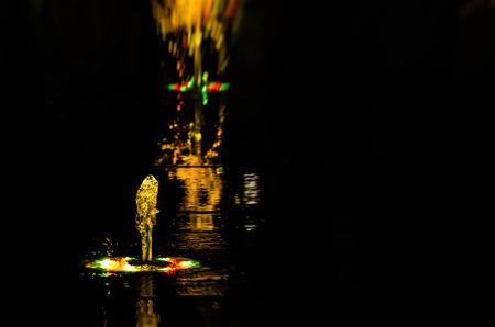 VOLCANO - Colorful fountain in the night city landscape