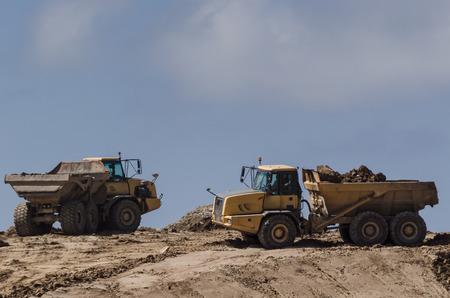 DUMP TRUCKS - Vehicles on the construction site