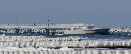 WINTER ATTACK ON THE SEA SHORE - Icy palisades and pier on the sea coast in Kolobrzeg
