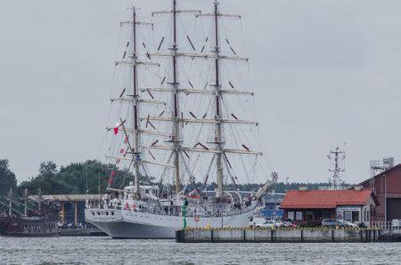 SWINOUJSCIE, WEST POMERANIAN  POLAND - 2017: Frigate DAR MLODZIEZY is sailing to the port Editorial