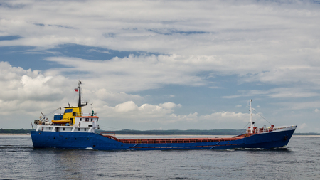 GENERAL CARGO SHIP - Freighter is sailing on the sea Stock Photo