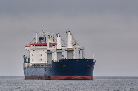 GENERAL CARGO SHIP - Freighter entering the port 版權商用圖片