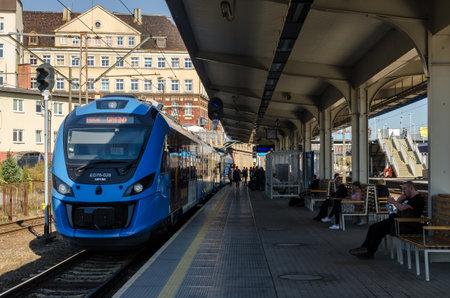 SZCZECIN, WEST POMERANIAN / POLAND - 2018: Modern passenger train are waiting for passengers on the platform