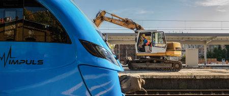 SZCZECIN, WEST POMERANIAN  POLAND - 2018: A modern passenger train waiting for travelers, working on the railway station Editorial