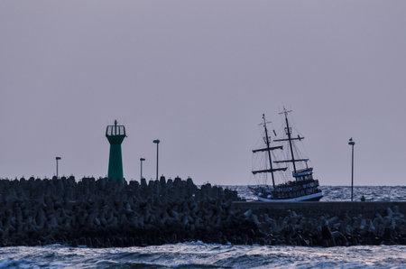 KOLOBRZEG, WEST POMERANIAN  POLAND - 2018: A cruise ship on the road over the sea coast