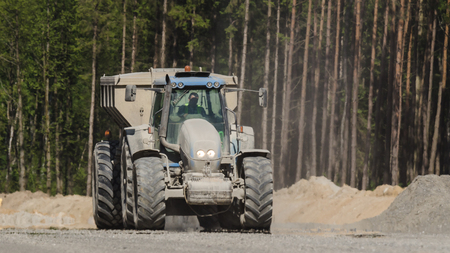 TRACTOR WITH A TRAILER - The vehicle on construction site