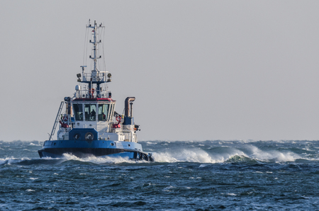 TUGBOAT - Ship on the storm sea Stock Photo