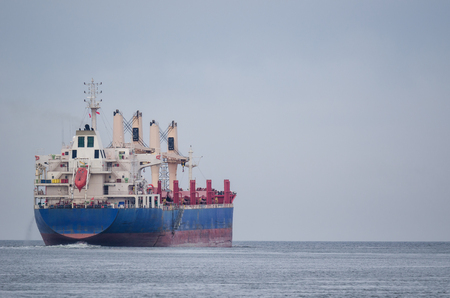 FREIGHTER - Merchant vessel at Sea Фото со стока