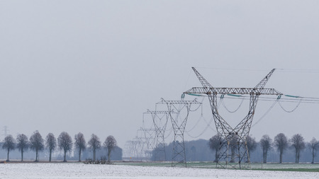POWER ENGINEERING - High voltage line among fields Banco de Imagens